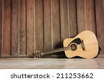 wooden guitar lying against the ... | Shutterstock . vector #211253662