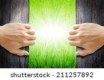 hand opening the wooden door to ... | Shutterstock . vector #211257892