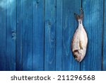 Raw Fish Hanging On A Blue...