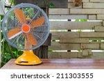 Retro Electric Fan On Wood Shelf