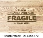fragile word stamp on wood... | Shutterstock . vector #211356472