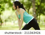 stretching woman in outdoor... | Shutterstock . vector #211363426