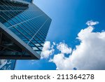 skyscrapers with a cloudy sky | Shutterstock . vector #211364278