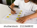 young caucasian girl doing her... | Shutterstock . vector #211368832