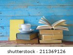 vintage books with a cup of... | Shutterstock . vector #211369126