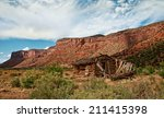an old pioneer cabin sits in a... | Shutterstock . vector #211415398
