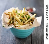 Small photo of truffle fries standing up in a bowl with wax paper lining