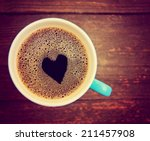 a cup of coffee with a heart... | Shutterstock . vector #211457908