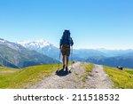 backpacker in mountains | Shutterstock . vector #211518532