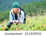 young blonde girl picking... | Shutterstock . vector #211535932