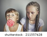 sister jealous brother who eats ... | Shutterstock . vector #211557628