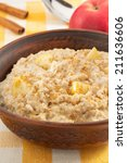bowl of oatmeal on tablecloth...   Shutterstock . vector #211636606