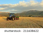 tractor in a fresh cut hay... | Shutterstock . vector #211638622