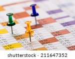 pins on calendar | Shutterstock . vector #211647352
