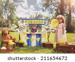two little kids are selling... | Shutterstock . vector #211654672