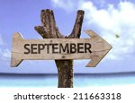 september sign with a beach on... | Shutterstock . vector #211663318