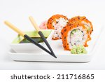 chopsticks and sushi on the... | Shutterstock . vector #211716865