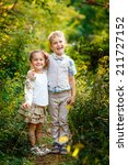 boy with his sister in the park | Shutterstock . vector #211727152