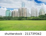 city and grass with blue sky | Shutterstock . vector #211739362