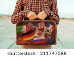 Woman Holds Small Retro...