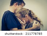 sad woman hugging her husband | Shutterstock . vector #211778785