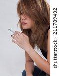 portrait of woman smoking on... | Shutterstock . vector #211789432
