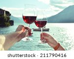 two wineglasses in the hands... | Shutterstock . vector #211790416