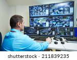 security guard watching video... | Shutterstock . vector #211839235