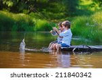 Two Young Cute Boys Fishing On...