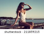 young beautiful woman sit at...   Shutterstock . vector #211859215