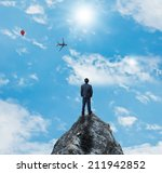 businessman on highest place | Shutterstock . vector #211942852