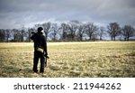 photographer on the field | Shutterstock . vector #211944262