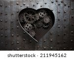 Heart Hole In Old Metal With...