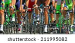 muscular legs of cyclists who... | Shutterstock . vector #211995082