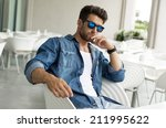 young handsome man in sunglasses | Shutterstock . vector #211995622