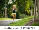 young lady running. woman... | Shutterstock . vector #212037205