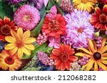 Stock photo festive vibrant floral background with a large arrangement of colorful summer flowers in rainbow 212068282