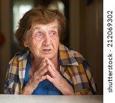 closeup emotional elderly woman ... | Shutterstock . vector #212069302