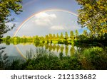 Bright Rainbow Reflected In A...