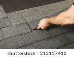 applying roof shingles | Shutterstock . vector #212157412