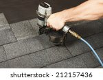 new roof shingle being applied | Shutterstock . vector #212157436