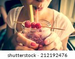 Young Woman Drinks Fresh Iced...