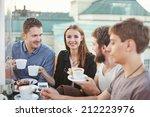 People Enjoying Coffee Togethe...