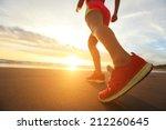 Woman Runner Feet Running On...