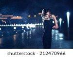 beautiful woman in black dress... | Shutterstock . vector #212470966