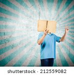young man with opened book.... | Shutterstock . vector #212559082