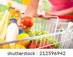 full shopping cart at store... | Shutterstock . vector #212596942