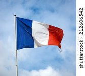 French Flag Against Blue Cloudy ...