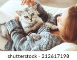 Stock photo child playing with cat at home 212617198