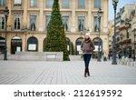 young girl on a parisian street ... | Shutterstock . vector #212619592